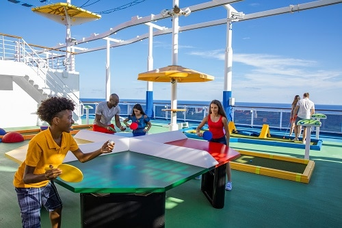 kids playing table tennis at sportsquare on board a carnival cruise ship