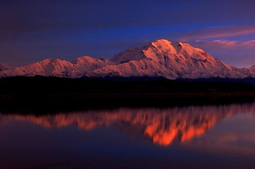 snowcapped mountains in alaska at sunset