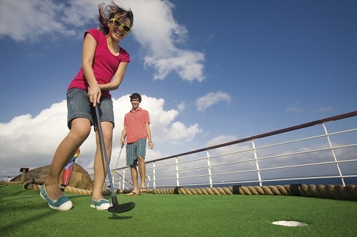 girl and boy playing mini golf on carnival valor