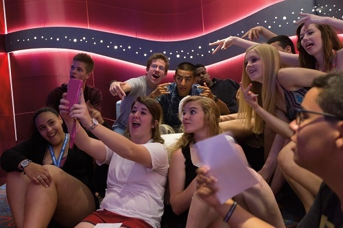 group of teens taking a selfie at club o2