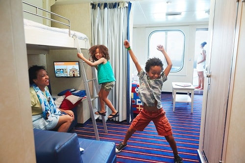 mom and her kids dancing in a carnival harbor stateroom