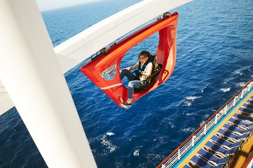 girl riding skyride on a carnival ship