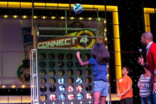 girl playing connect 4 during hasbro the game show