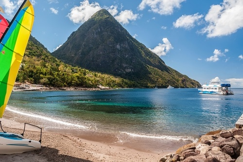 st lucia beach with pitons in sight