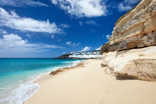 white sand beach and cliffs of st maarten