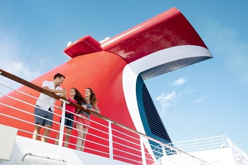 family embarking on a carnival cruise ship
