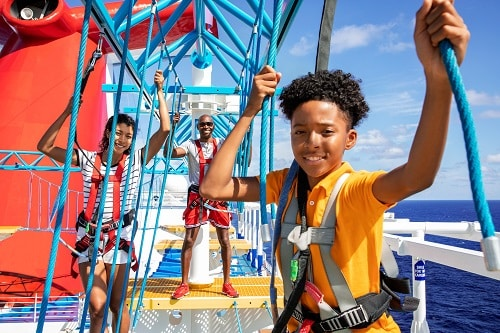 family having fun on the ropes course aboard a carnival ship