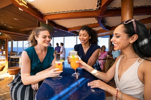 groups of girlfriends having a drink together at the redfrog pub on a carnival ship