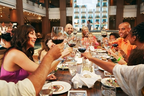 group of friends gathered for dinner on a carnival ship