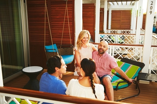 friends talking out on a stateroom balcony