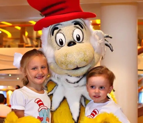 children meeting a dr seuss character at the green eggs and ham breakfast