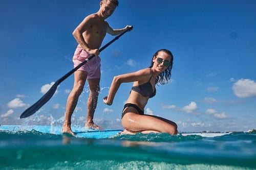 couple paddleboarding together