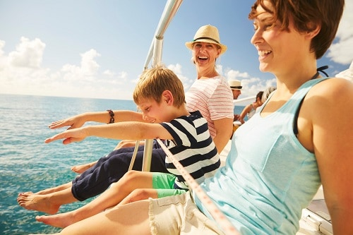 family on a catamaran in the caribbean