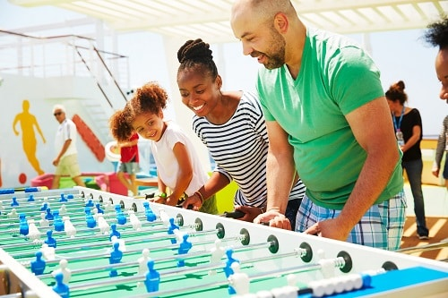 family playing foosball together in sportsquare