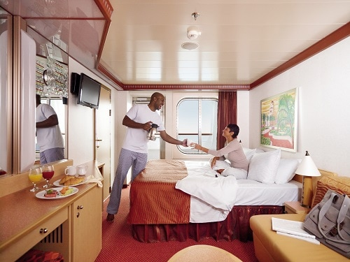 happy couple in a clean stateroom onboard a carnival ship