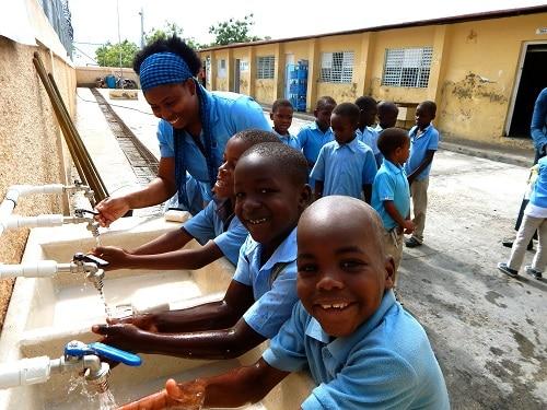 little boys washing their hands