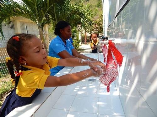 little girls washing their hands