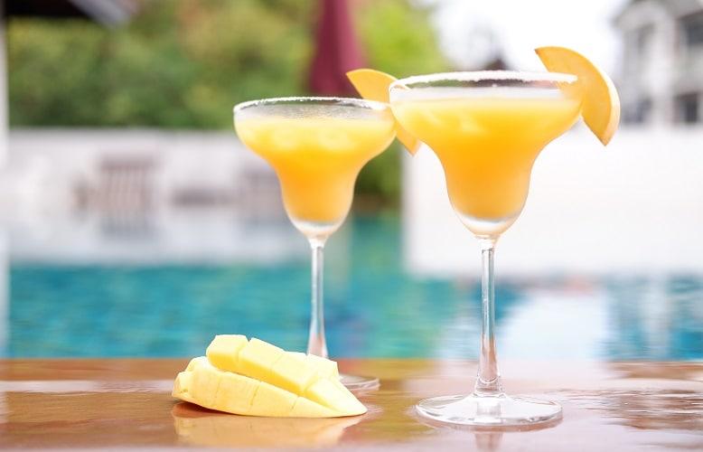 mango margarita at swimming pool
