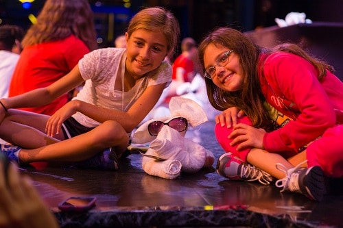 two girls smiling with their towel animal at the towel animal theater