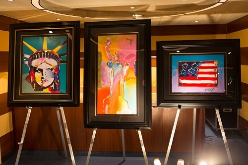 art pieces on display on a carnival ship