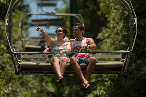 couple riding on a sky lift as part of a shore excursion in the caribbean