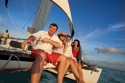 group of people enjoying the day on a catamaran