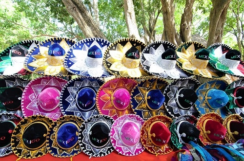 rows of colorful mexican sombreros on display