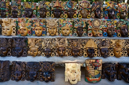 rows of wooden masks on display in ensenada