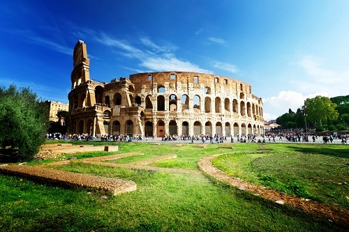 the sun shining down on the roman colosseum