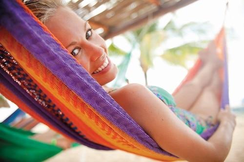 woman resting on a hammock in cozumel