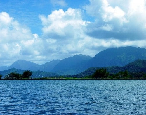 a landscape view of many mountains and bodies of water in hawaii