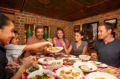 family dining on an italian feast from cucina del capitano