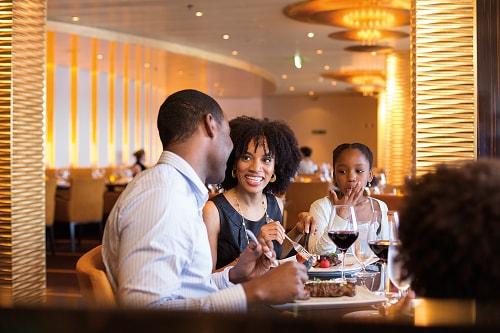 family enjoying a wonderful dinner at fahrenheit 555 steakhouse