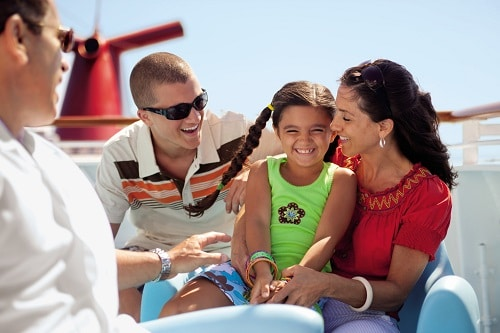 family enjoying their time on a deck onboard a carnival cruise ship