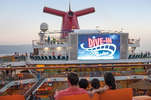 family settling in to start watching a feature movie onboard a carnival ship