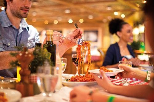 family sharing a spaghetti at cucina del capitano