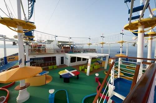 the interior of sportsquare onboard a carnival ship