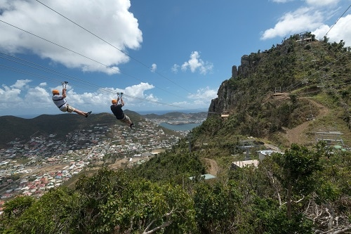 two people zip lining across st. maarten