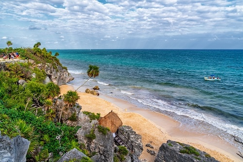a glimpse into a beach on the yucatan peninsula