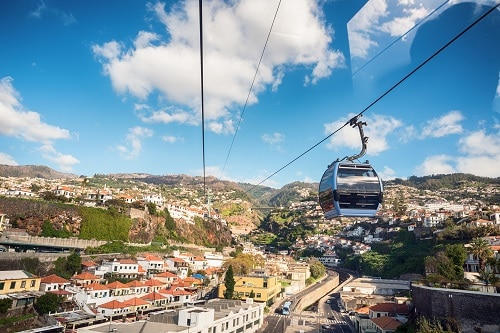 a small cable car coming back down to funchal