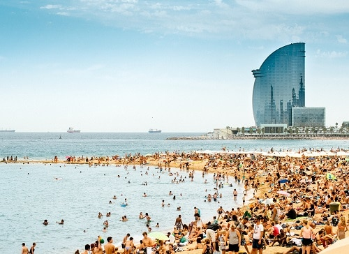 an aerial view of la barceloneta on a busy day