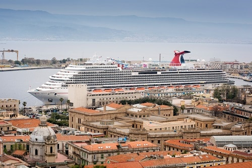 carnival horizon pulling into the port of messina in italy