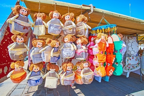 colorful textile dolls at a marketplace in malta