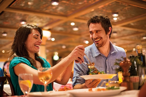 couple sharing a salad at cucina del capitano onboard a carnival ship