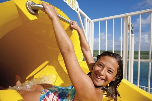 girl about to slide down the twister waterslide