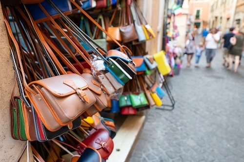 leather bags on display at an italian marketplace