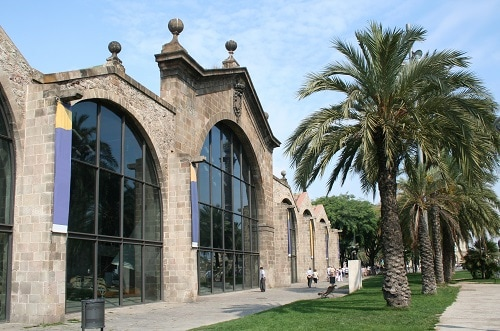 the outside of a nautical museum in barcelona