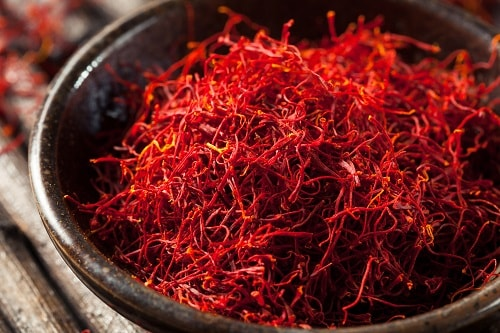 a bowl of raw, organic, red saffron