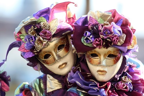 a couple wearing masquerade masks