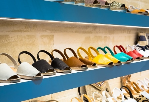 a display of different colored avarca sandals in a shoe store